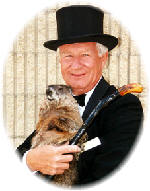 Punxsutawney Phil  with former Groundhog Club President Bud Dunkel.  Photo courtesy of Alan Freed / PunxsutawneyPhil.com