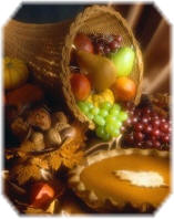 Thanksgiving Cornucopia and Pumpkin Pie - © corbis